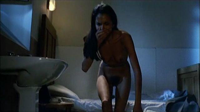 actress Laura Gemser 18 years undress image in the club