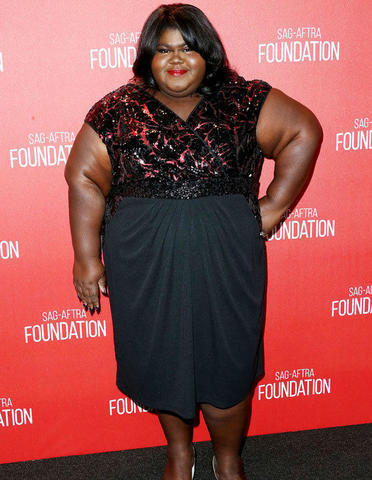 models Gabourey Sidibe young flirtatious picture in the club