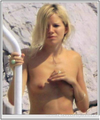 actress Sienna Miller 20 years chest snapshot beach
