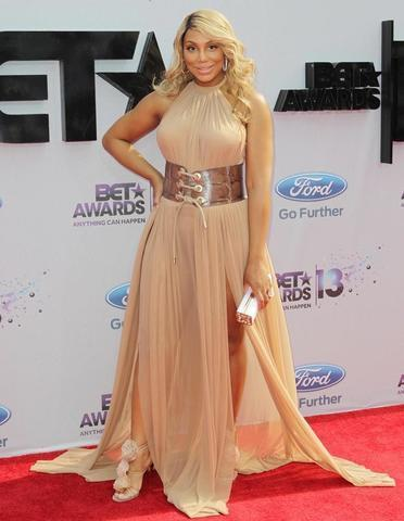 celebritie Tamar Braxton 25 years mammilla foto home